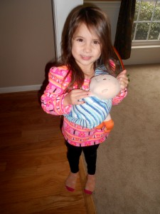 Sew Attached Pouch Doll Carrier - 3 year old Marcella wearing Baby Stella